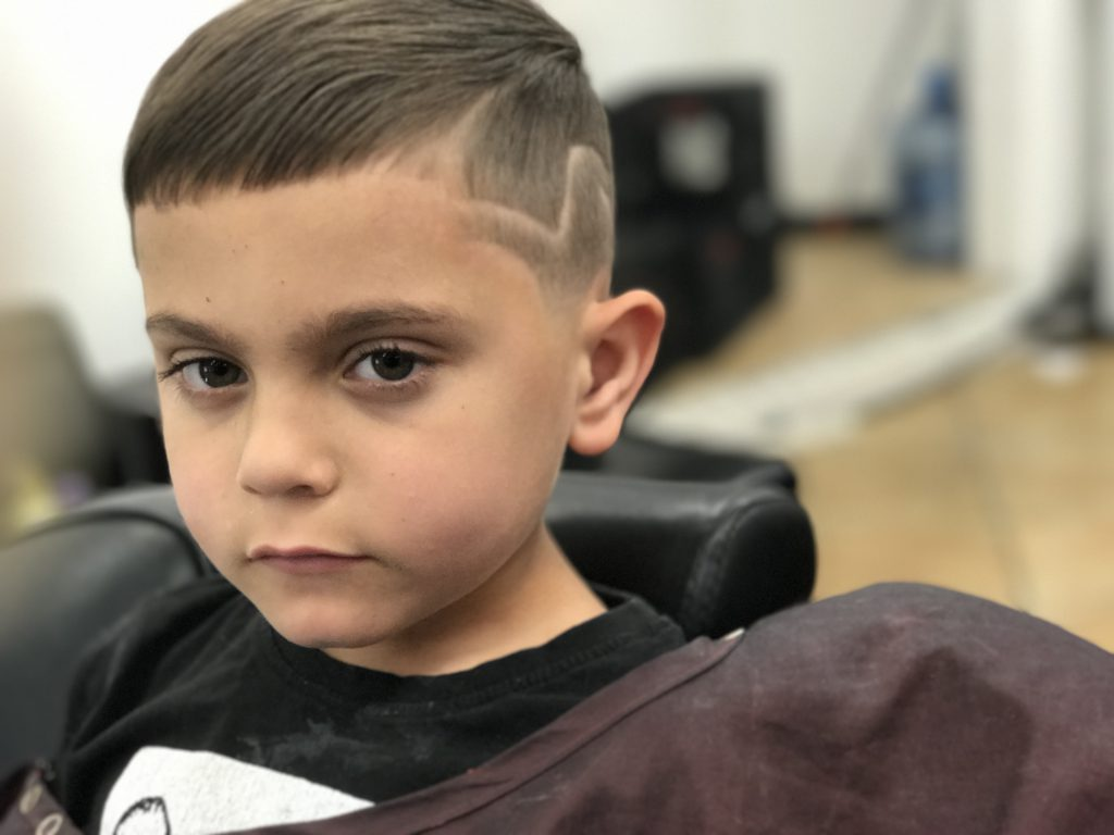 Picture of a handsome little boy and his haircut